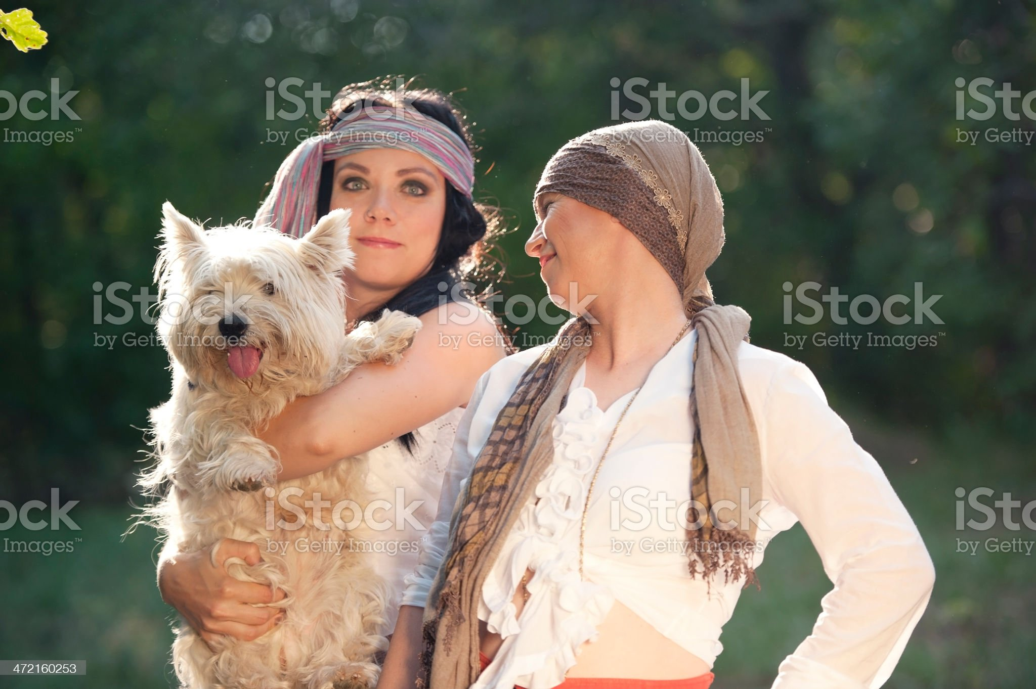 Two Gypsy Women with Dog royalty-free stock photo