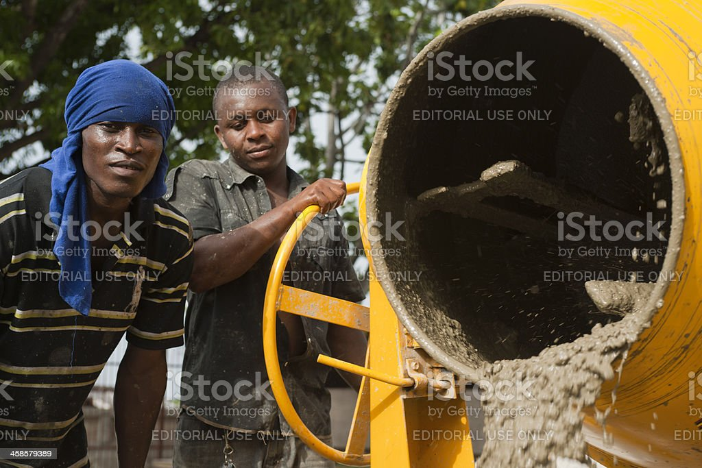 Two haitian construction workers stock photo