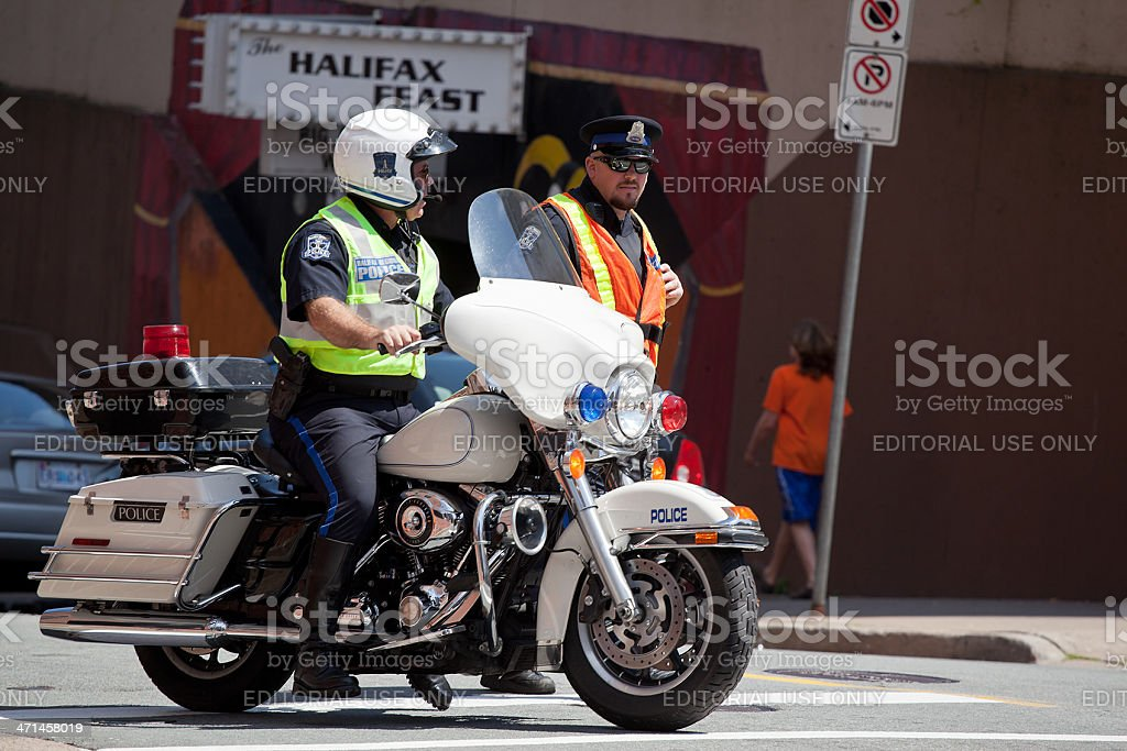 Two Halifax Regional Police Officers in Intersection stock photo