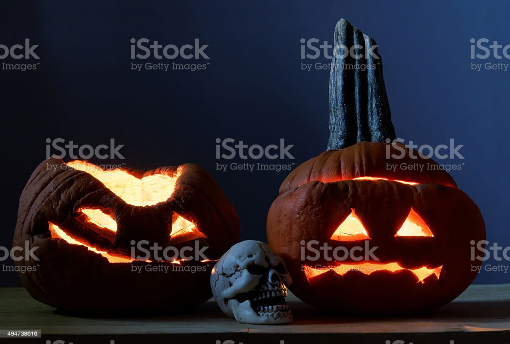 Two halloween pumpkins and scull stock photo