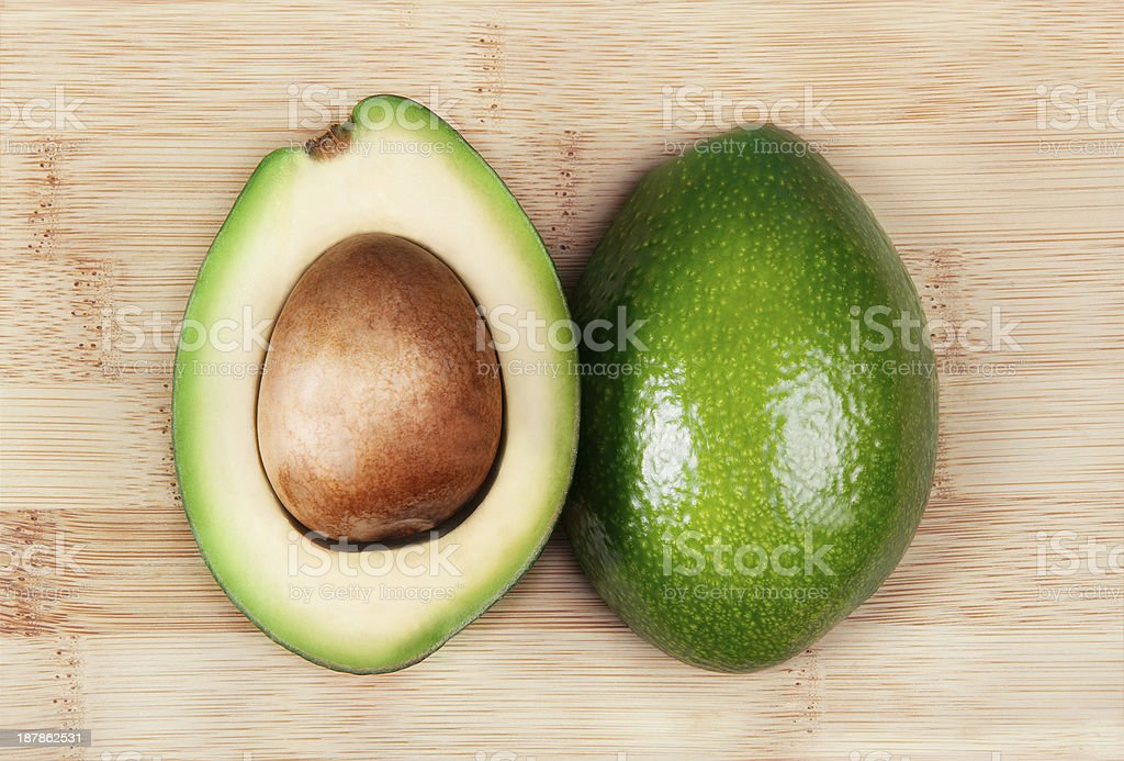 Two halves of avocado royalty-free stock photo
