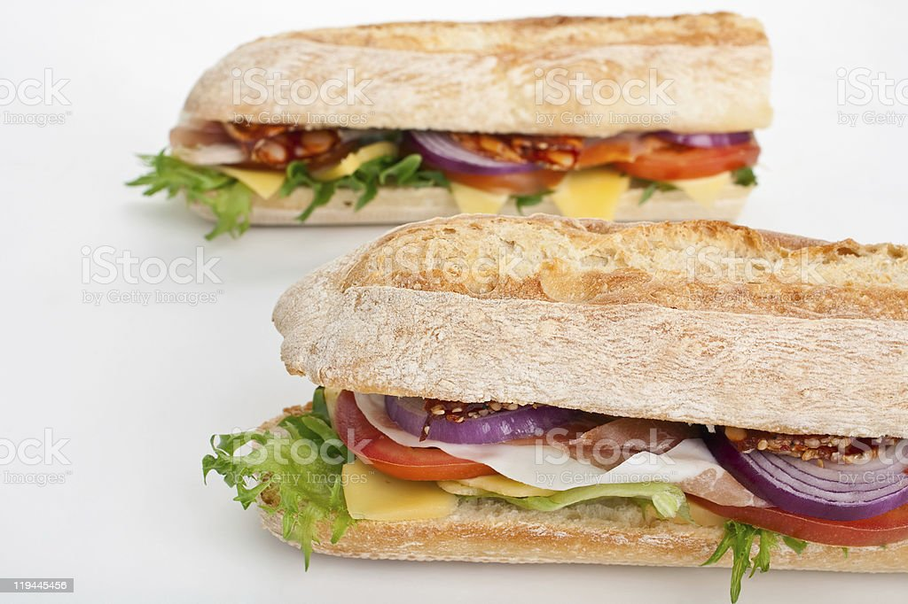 two halves of long white  baguette sandwich royalty-free stock photo