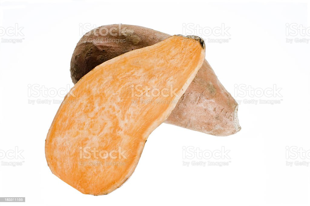 Two Halves Of Sweet Potato Ipomoea Batatas Isolated Against White stock photo
