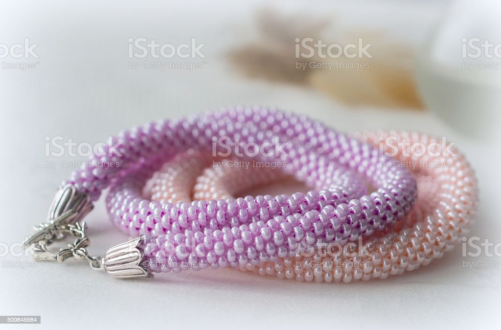 Two handmade necklaces from pink and lilac beads stock photo
