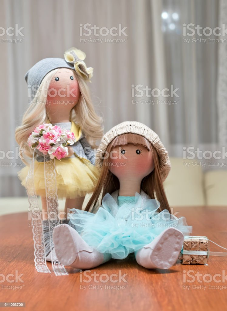 Two handmade rag dolls - blonde and brown-haired stock photo