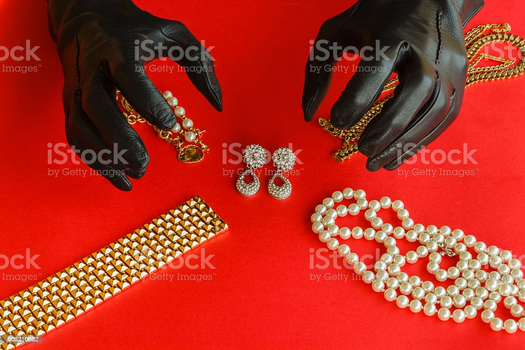 two hands  are going to steal the jewels stock photo
