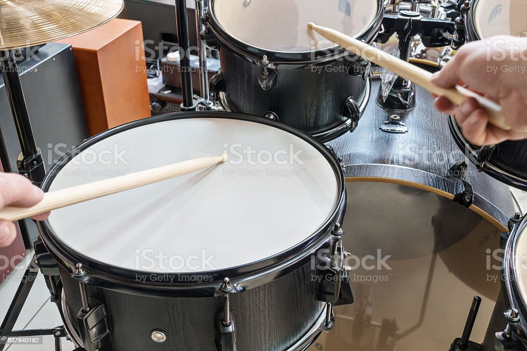 Two hands beat into a drum stock photo