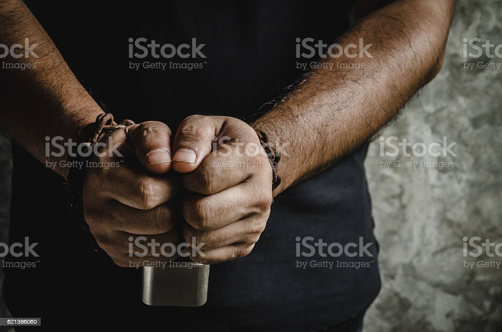 Two hands chained with old rusty chain and a padlock stock photo