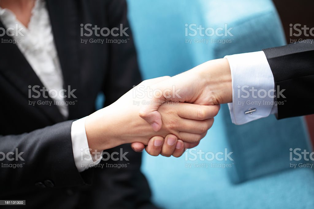 Two hands confirming a potential business transaction royalty-free stock photo