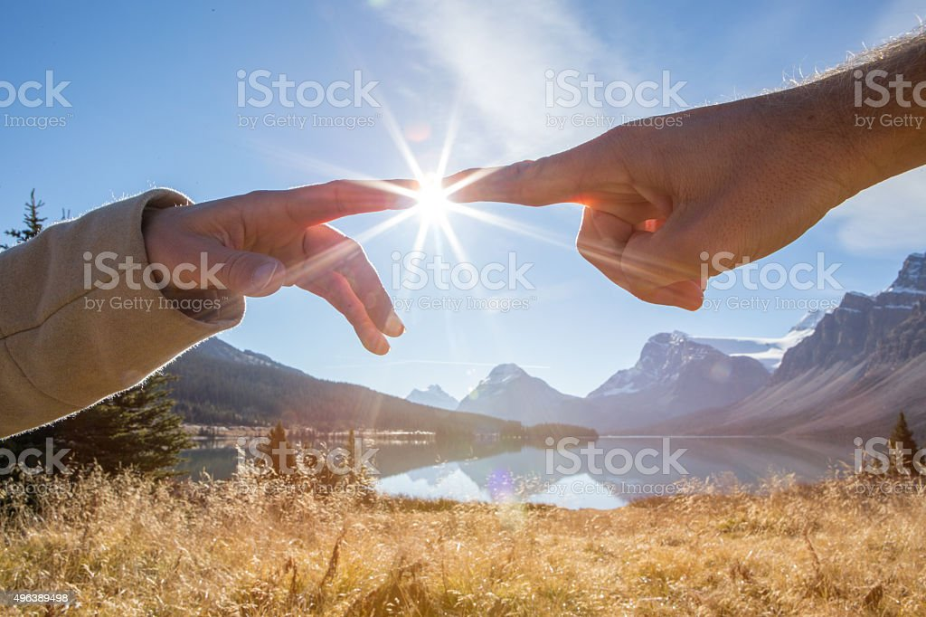 Two hands connecting stock photo