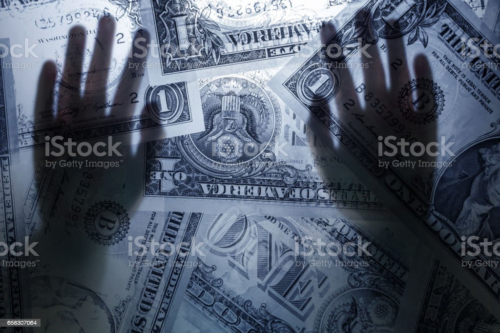 two hands cover the us dollar paper currency stock photo