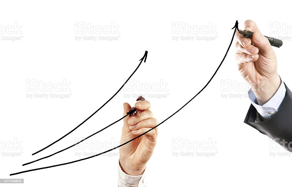 Two hands drawing a diagram royalty-free stock photo