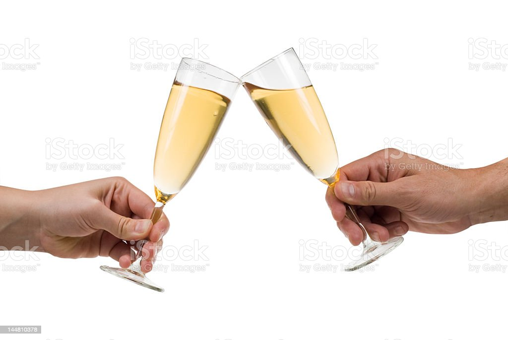 Two hands, each clinking together a glass of champagne royalty-free stock photo