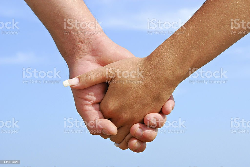 Two hands embraced representing togetherness  stock photo