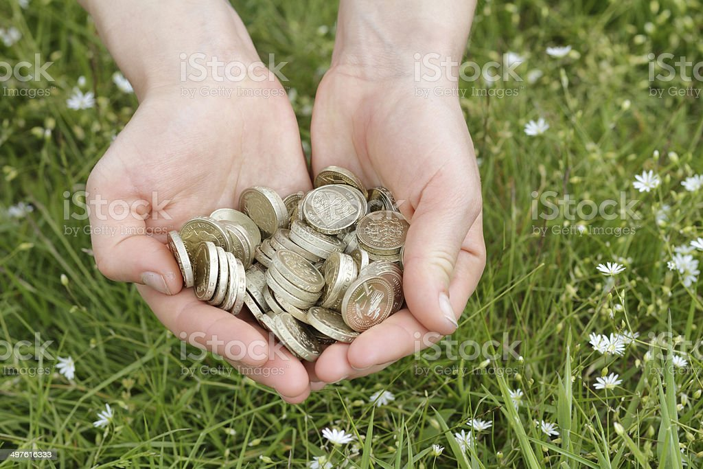 Cash in the countryside pounds by the handful stock photo