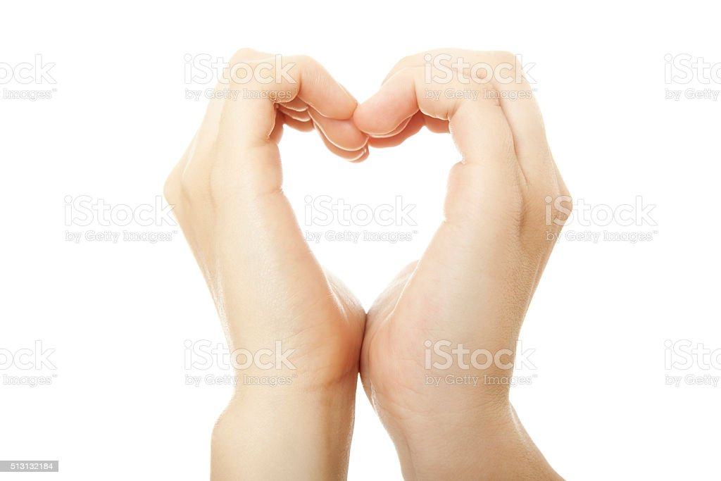two hands forming one heart stock photo