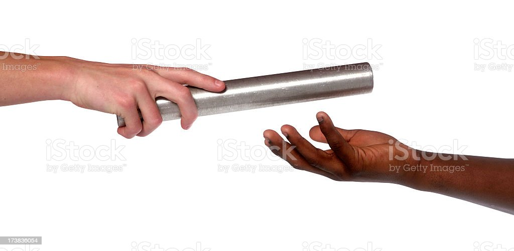 Two hands, giving and receiving a track baton in a race stock photo