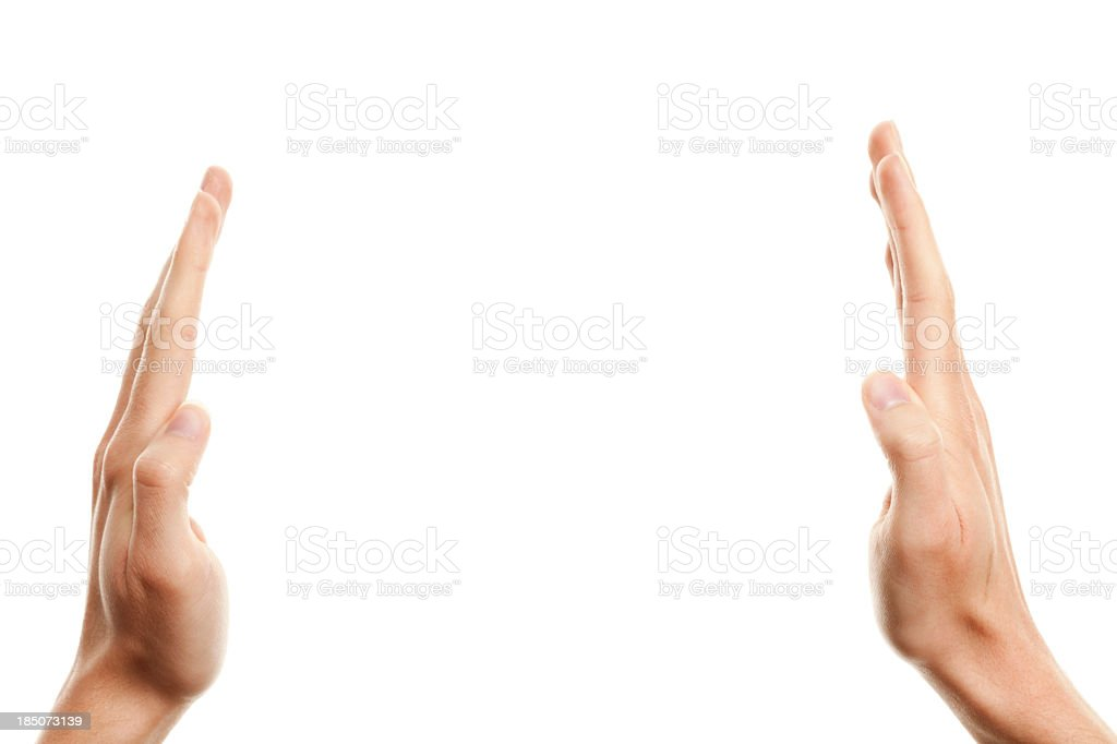 Two hands going towards one another isolated on white royalty-free stock photo