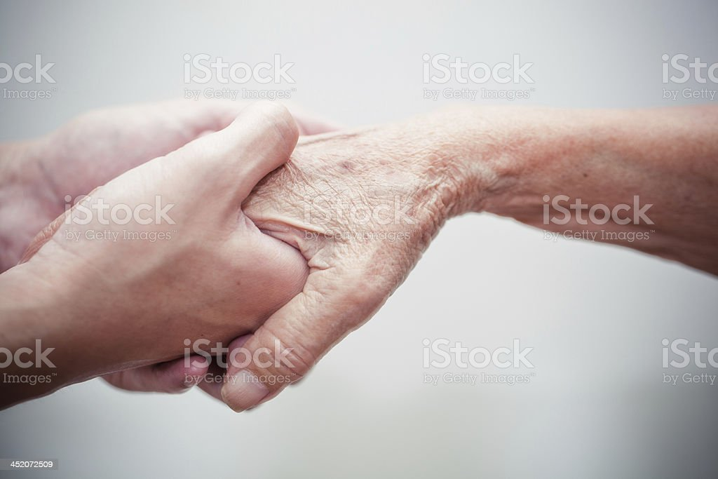 Two hands grasping another in helpful gesture royalty-free stock photo