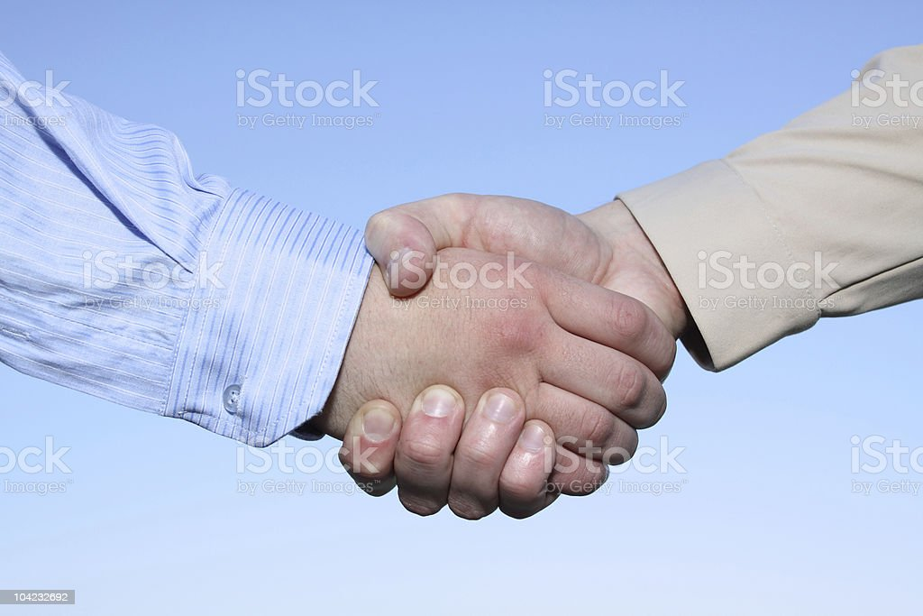 Two hands handshake isolated on sky background royalty-free stock photo