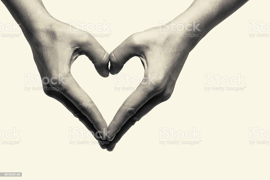 Two hands - heart stock photo