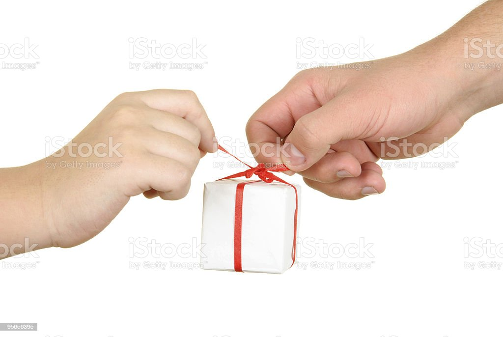 Two hands hold  box with  gift royalty-free stock photo