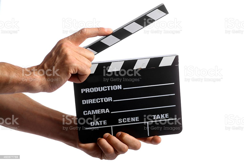 Two hands holding a cinema director's cut board stock photo