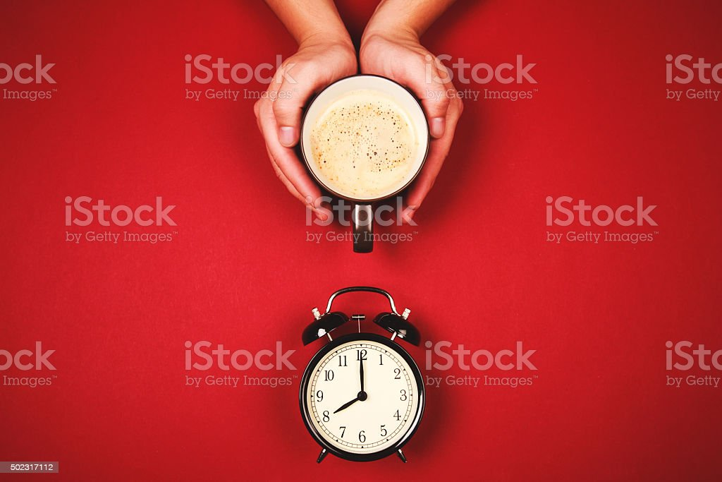 Two hands holding a cup of fresh coffee stock photo