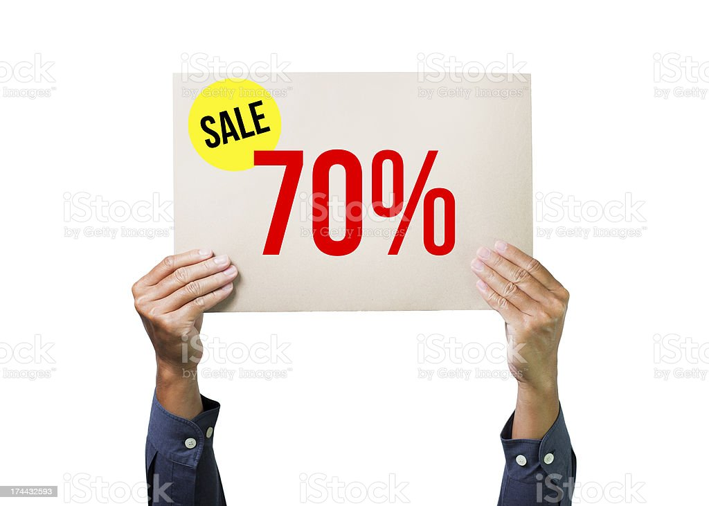 Two hands holding brown cardboard with sale 70% stock photo