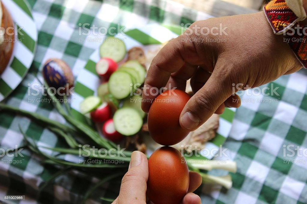 Two hands holding Easter painted eggs stock photo