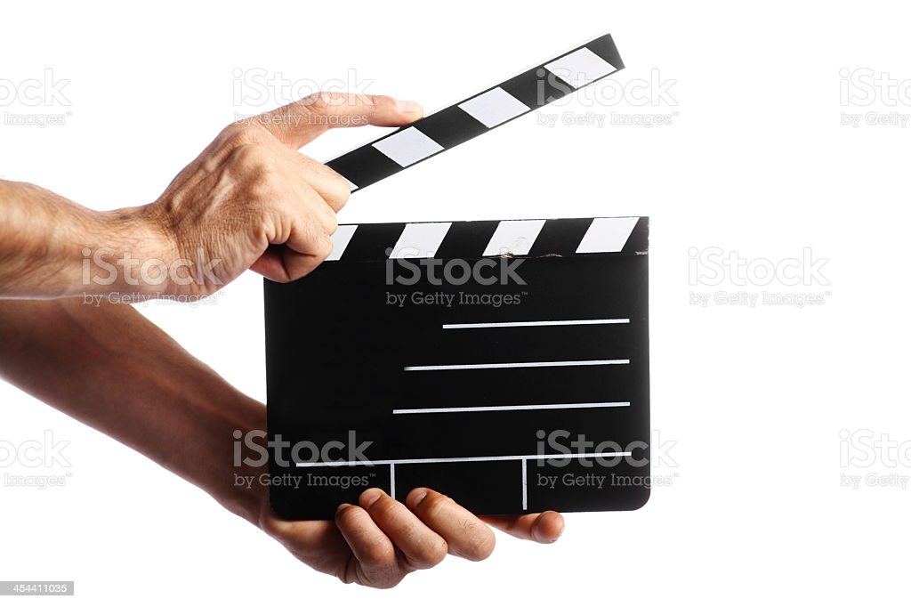 Two hands holding film clapper on white background stock photo