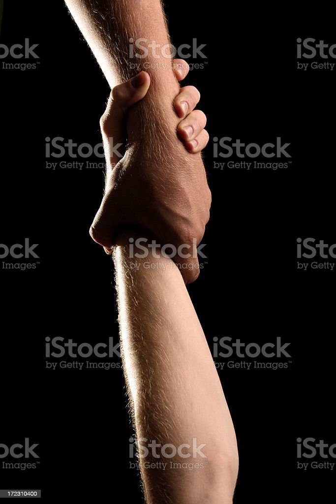 Two hands holding on vertically on black background royalty-free stock photo