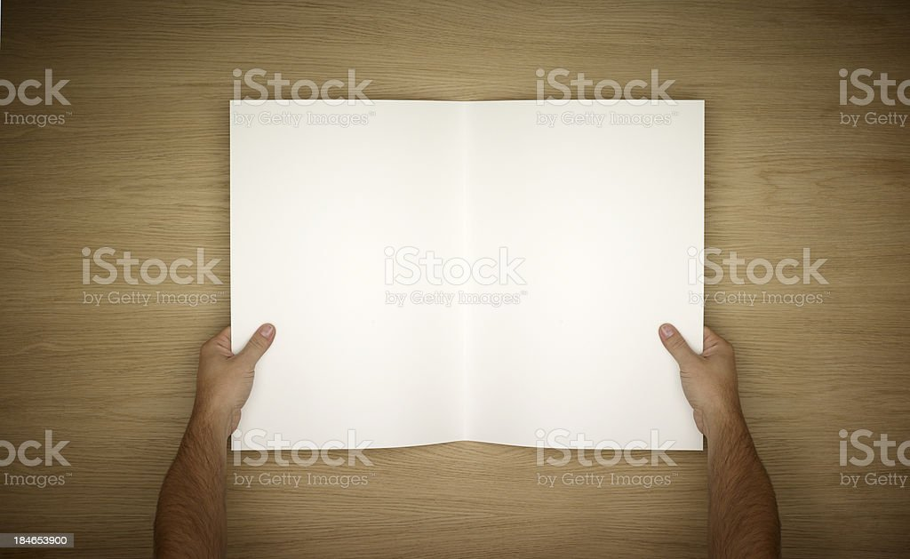 Two Hands Holding Open A Blank Magazine royalty-free stock photo
