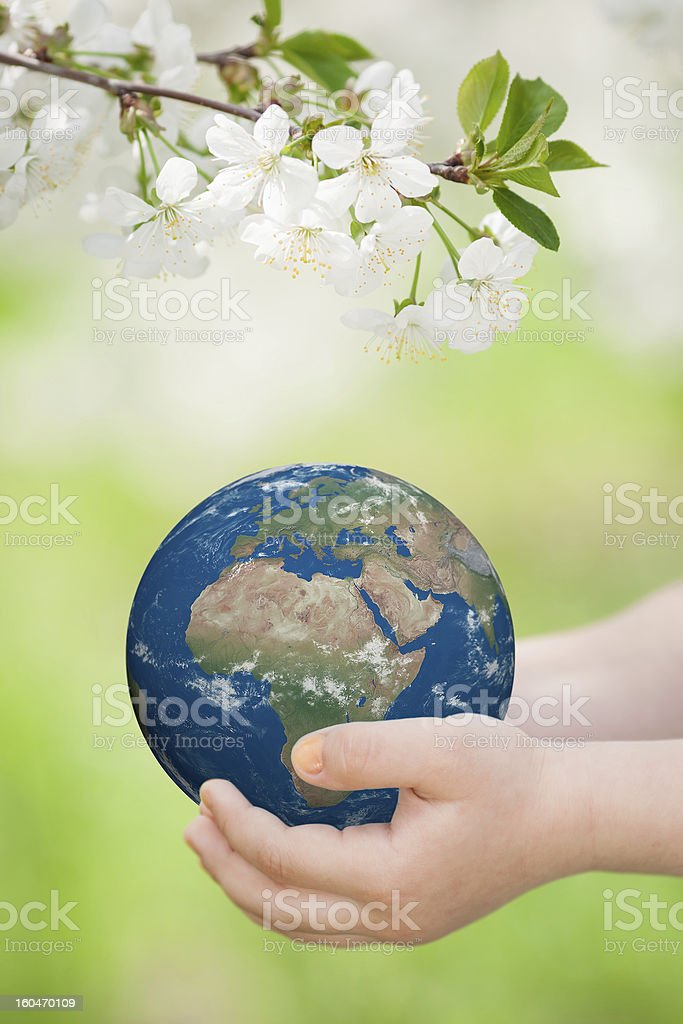 Two hands holding planet earth stock photo