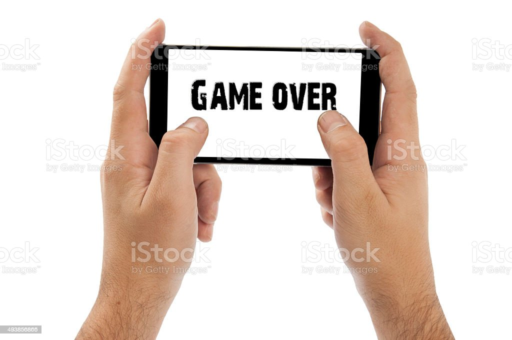 Two hands holding smart phone, playing games stock photo