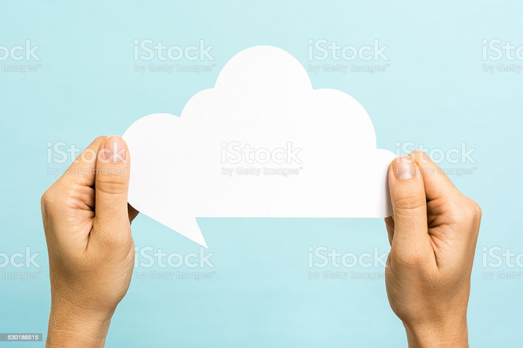 Two hands holding speech bubble. Social media, sharing, cloud concept. stock photo