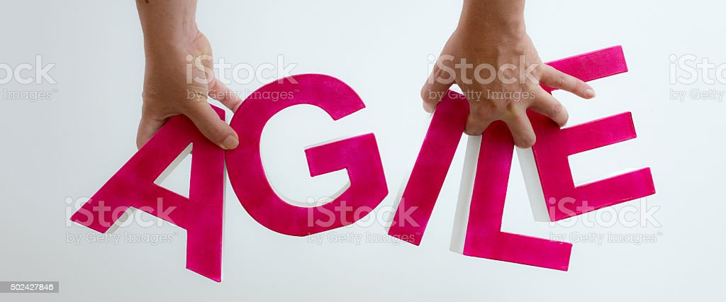 Two hands holding the word Agile stock photo