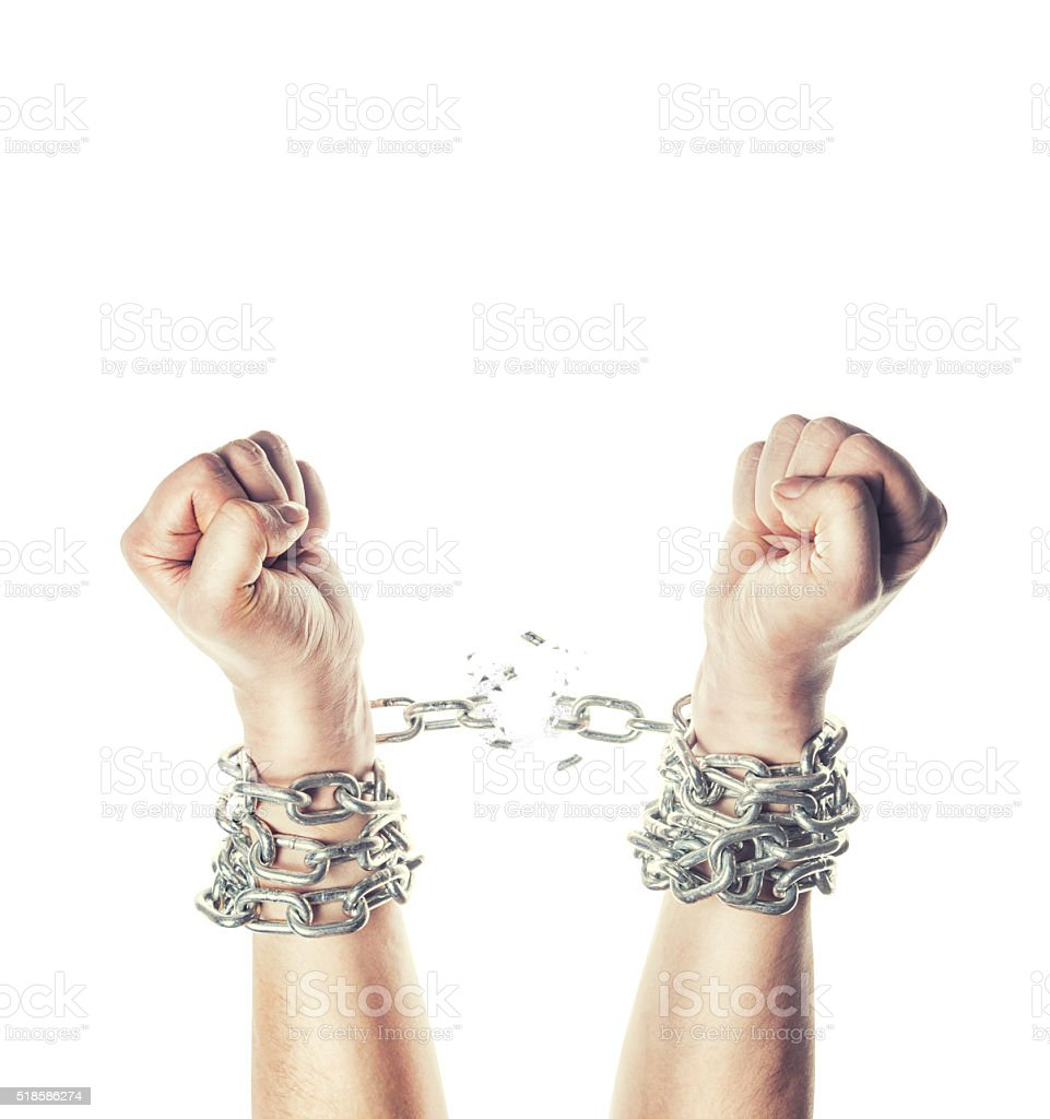 Two hands in chains stock photo