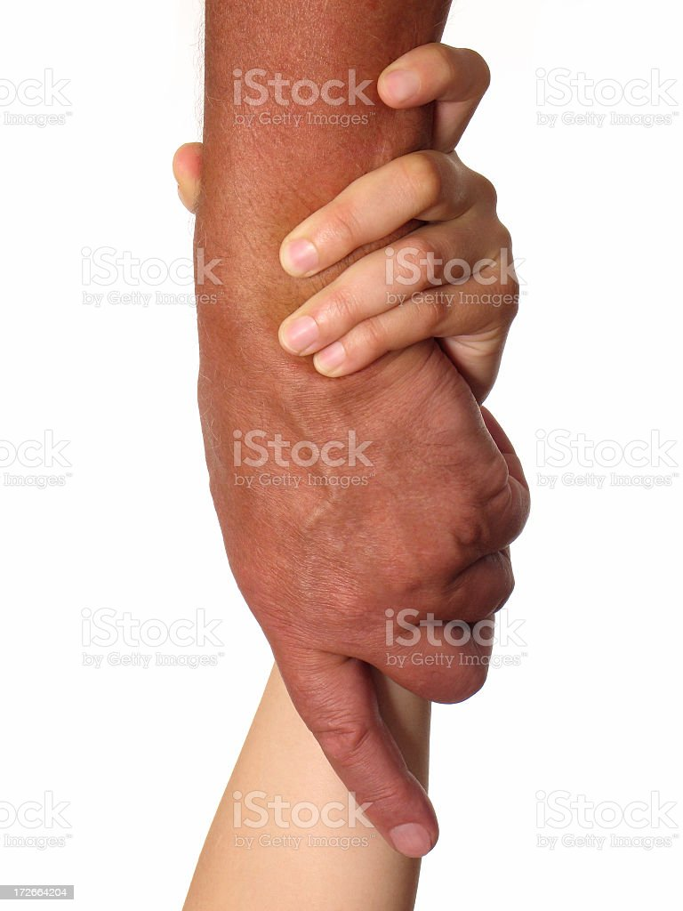 Two hands interlocked in rescuers grip royalty-free stock photo