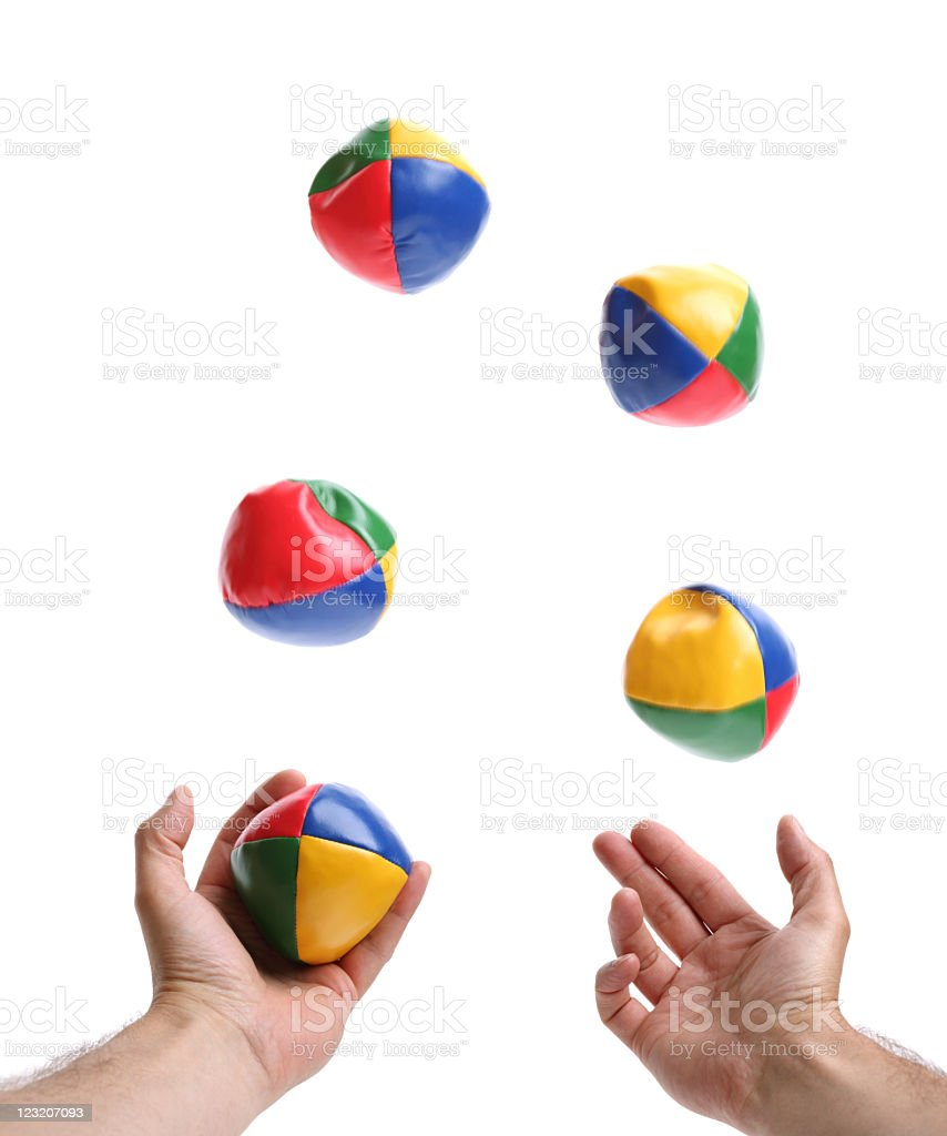Two hands juggling set of five colorful bean balls stock photo