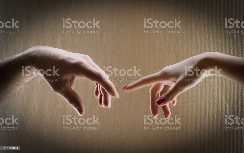 Two hands men and women are drawn to each other stock photo