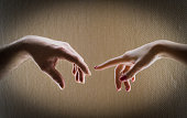 Two hands men and women are drawn to each other