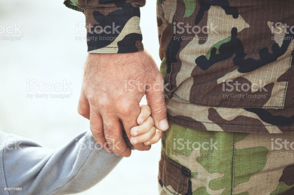 Two hands  of one family - father and child together. stock photo