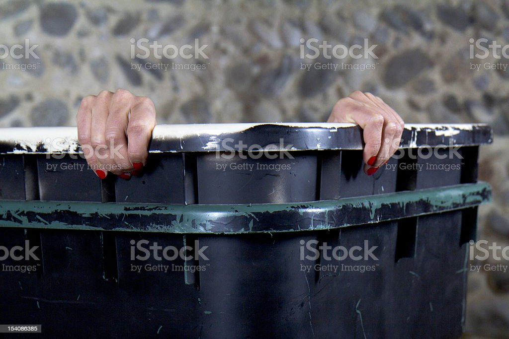 Two hands on the edge of a container. royalty-free stock photo