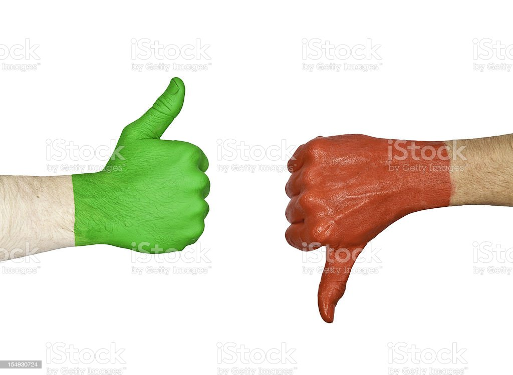 Two hands one painted green and the other red showing signs stock photo