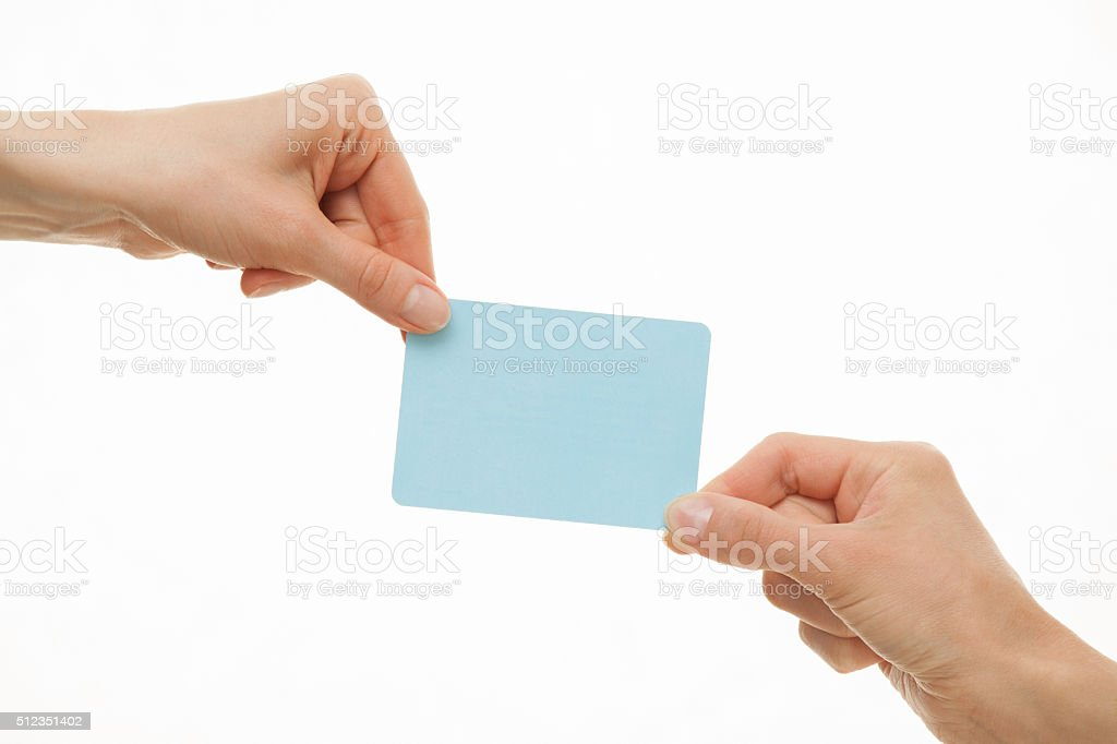Two hands pull in different directions a blue paper card stock photo