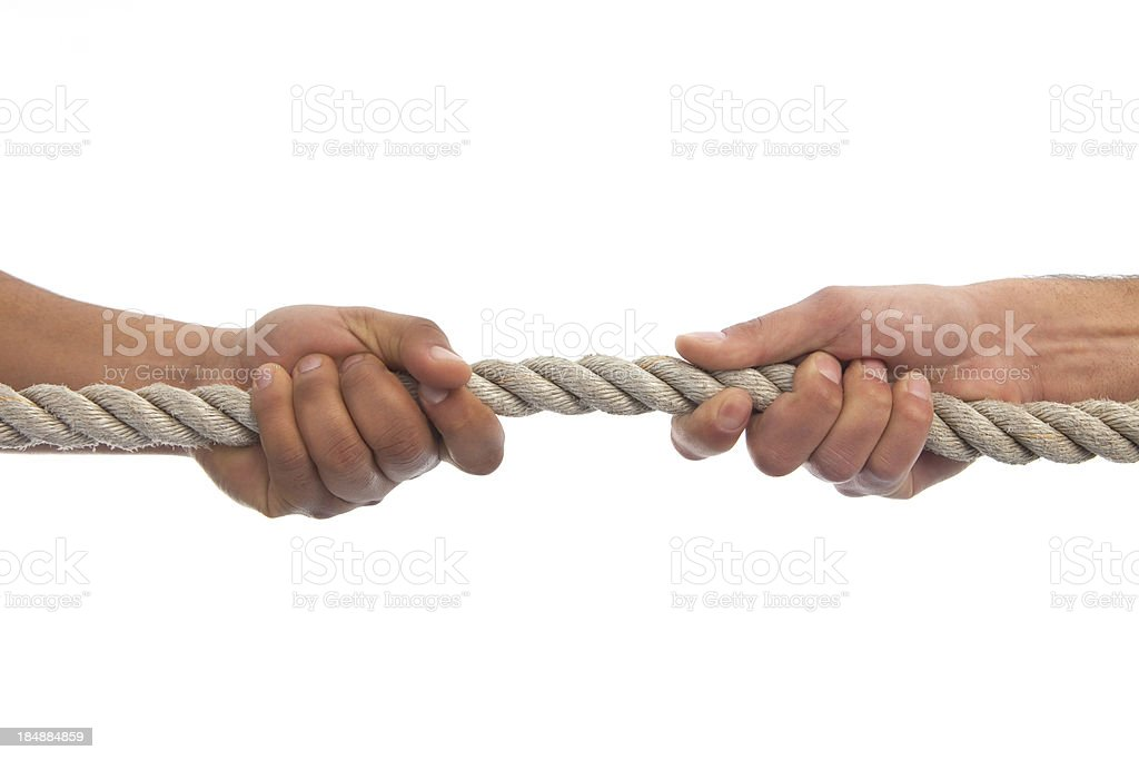 Two hands pulling a rope stock photo