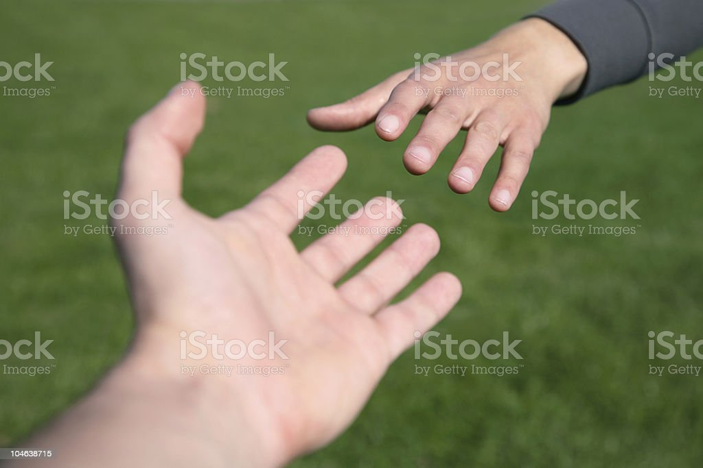 Two hands reaching out for each other royalty-free stock photo