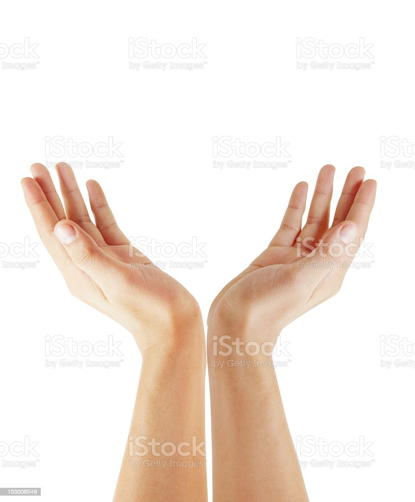 Two hands reaching up to the sky stock photo