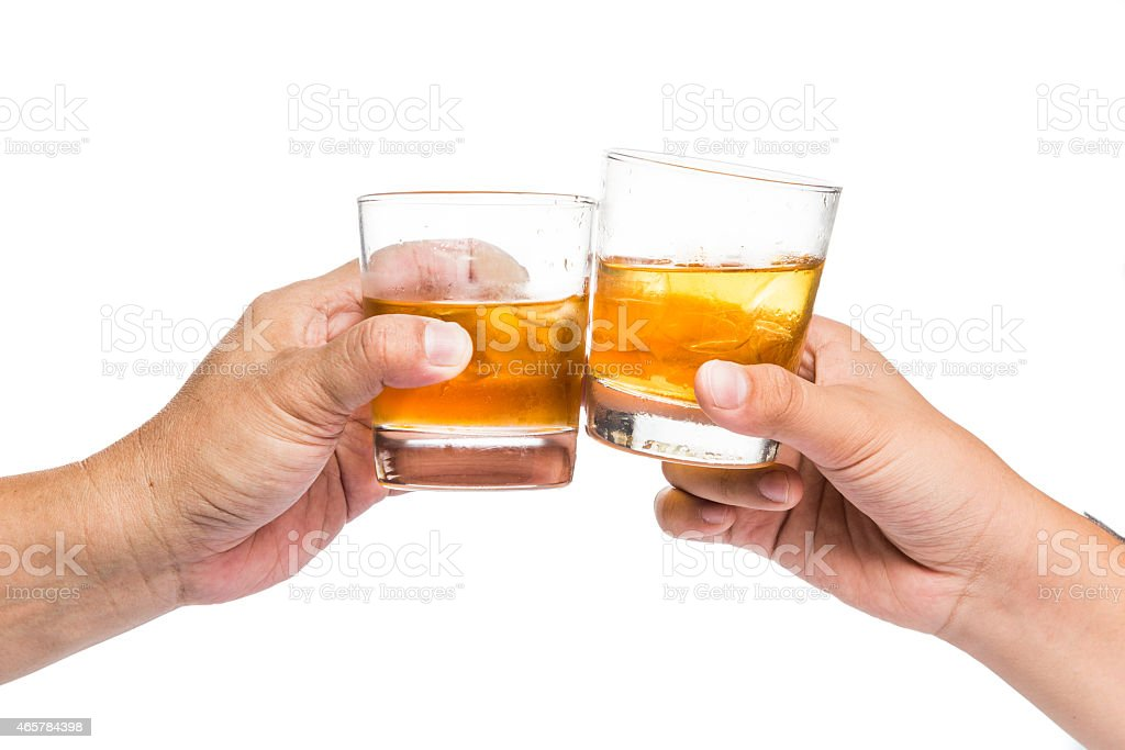 Two hands toasting whiskey on the rock with white background stock photo